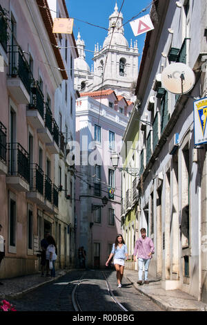 Street in the Alfama district, Lisbon, Portugal. - Stock Photo
