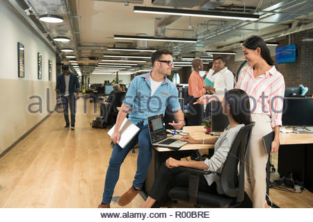 Colleagues talking in office - Stock Photo