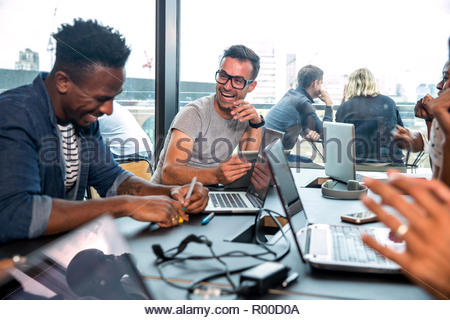 Colleagues using laptops during meeting - Stock Photo