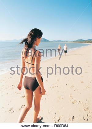 Woman wearing black bikini on beach - Stock Photo