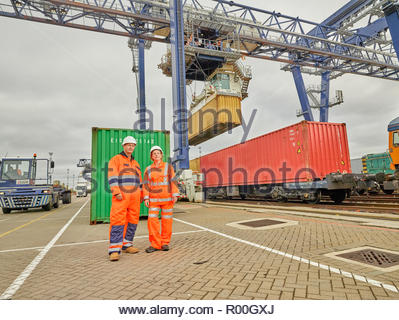 Dock workers by railway tracks at Port of Felixstowe, England - Stock Photo