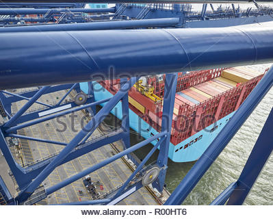 looking down onto cargo on ship from crane above the sea. - Stock Photo