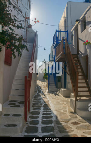 Mykonos, Greece. Whitewashed dotted alley in old town, Cyclades Greek Islands.Typical white Greek houses with blue doors and windows on narrow streets - Stock Photo