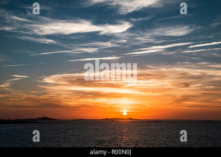 Sunset over Lihou Island, Guernsey. - Stock Photo
