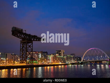 Night Time shot looking East down the River Clyde from Pacific Quay with the City Lights reflecting on the River Clyde. - Stock Photo
