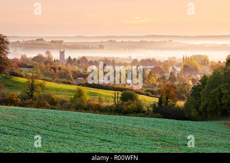 St James' church and misty autumnal cotswold landscape at sunset, Chipping Campden, Cotswolds, Gloucestershire, England, United Kingdom, Europe - Stock Photo