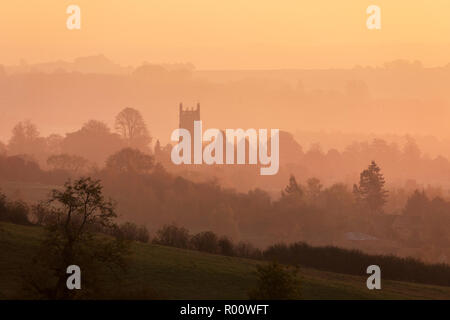St James' church and misty cotswold landscape at sunrise, Chipping Campden, Cotswolds, Gloucestershire, England, United Kingdom, Europe - Stock Photo