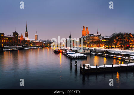 Zurich, Switzerland old town, situated on the Limmat river. Illuminated building in Zurich, Switzerland - the largest city in the country - Stock Photo
