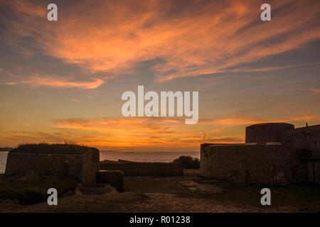 Sunset over Fort Hommet, Guernsey. - Stock Photo