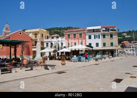 Harbour front tavernas at Gaios on the Greek island of Paxos on June 12, 2014. Gaios is the Capital of the 13km long island. - Stock Photo