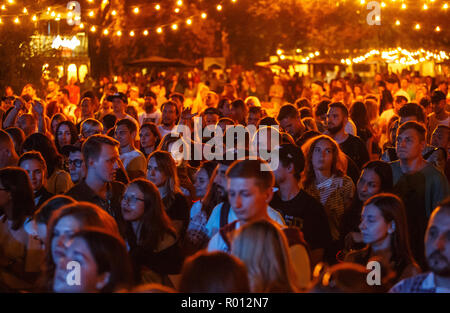 KIEV-11 JULY,2018: Concert crowd partying to the music at summer music festival Bazar.Group of young people party to hip hop dj playing set on scene.V - Stock Photo
