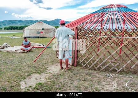 Khutag Ondor, Central Mongolia - July 17, 2010: Nomads construct traditional yurts called gers on central Mongolian steppe near Khutag Ondor village. - Stock Photo