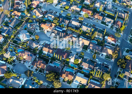 Late afternoon aerial view of modern suburban cul-de-sac streets and homes near Los Angeles in Simi Valley, California. - Stock Photo