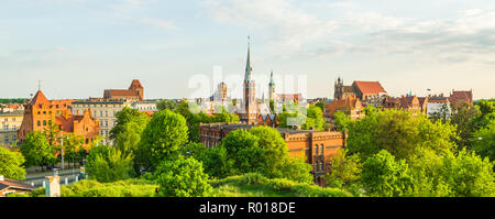 Rare seen Toruń old town panorama seen from north in golden hour light. - Stock Photo