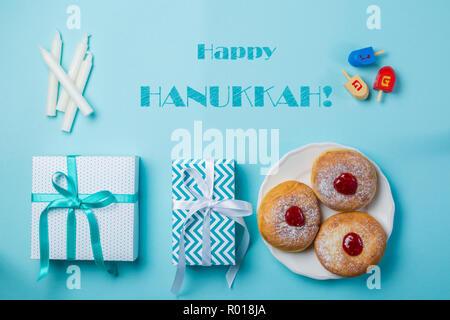 Symbols of hanukkah on blue background - Stock Photo