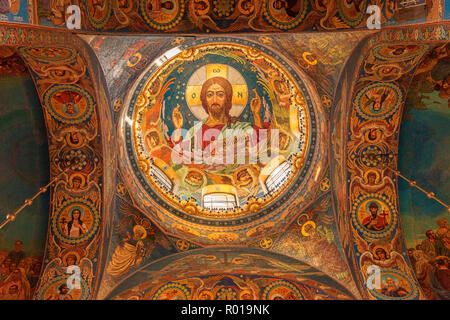 18 September 2018: St Petersburg, Russia - Jesus Christ, interior of the Church of the Saviour on the Spilled Blood, from directly below. - Stock Photo