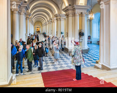 19 September 2018: St Petersburg, Russia - Tour parties in the entrance hall of the Hermitage Museum. - Stock Photo