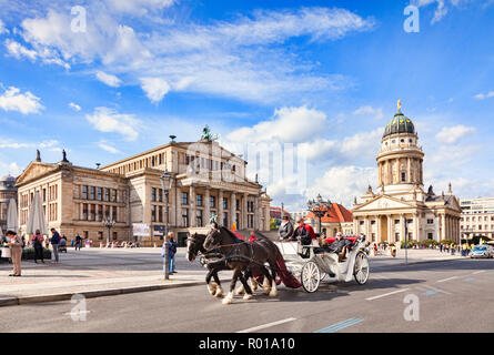 22 September 2018: Berlin, Germany - Horse-drawn carriage ride in Gendarmenmarkt Square, with the Konzerthaus on the left and the French Church on the - Stock Photo