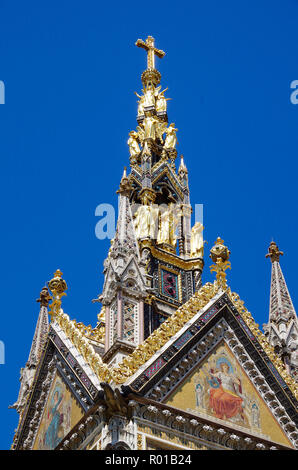 Detail of the spire, or flèche, of the profusely decorated Albert Memorial, in Kensington Gardens, London, in memory of Prince Albert, - Stock Photo