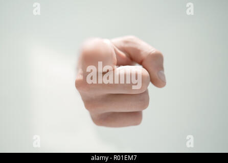 close up.a man's hand breaking through the paper and pointing so - Stock Photo