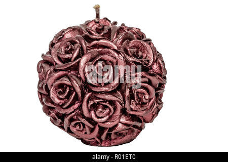 Purple candle with roses on a white background close up - Stock Photo