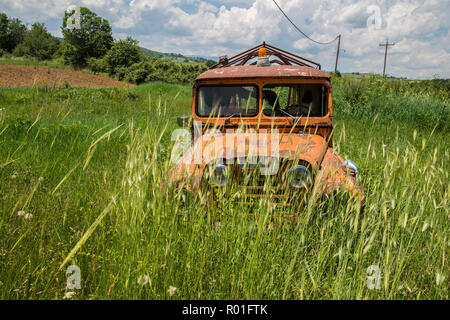 GREECE, KASTORIA. Abandoned wreck of a pick up truck in a field near Kastoria - Stock Photo