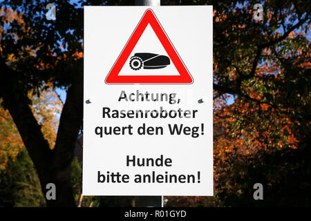 Warning sign for lawn mower robot, danger for free-running dogs, Schleswig-Holstein, Germany - Stock Photo