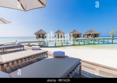 Luxury water villas in Maldives, tropical resort or hotel background. Exotic travel destination and