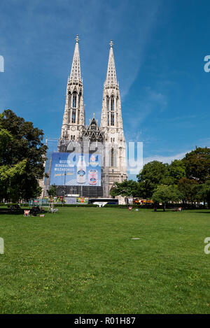 Votivkirche in Vienna turned billboard, an eyesore that lessens the city's readability and reveals dysfunctional local authorities. How dare they? - Stock Photo