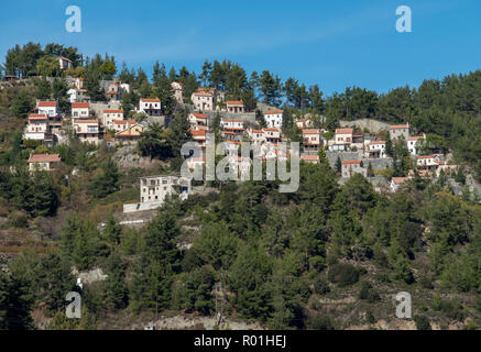 Houses perched on a rocky mountainside near Amiantos village, Cyprus. - Stock Photo