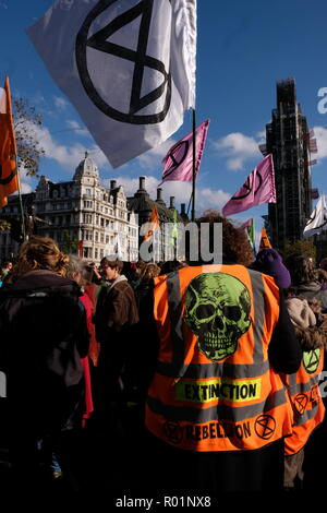 London, UK. 31st October, 2018. Climate protesters Extinction Rebellion gather in Parliament square for their 'Declaration of Rebellion' Credit: Londonphotos/Alamy Live News - Stock Photo