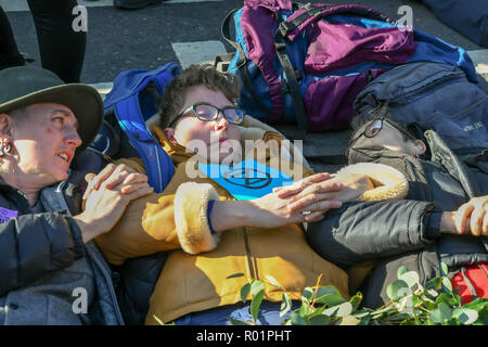 London, UK 31st October 2018  Environmental protesters block the road outside the House of Commons with a call to direct action over environmental issues.such as fracking. Credit Ian Davidson/Alamy Live News - Stock Photo