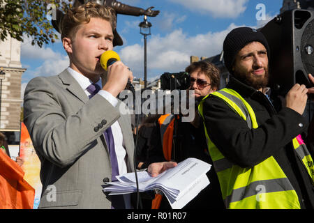 London, UK. 31st October, 2018. Bristol University student Robin Boardman-Pattison reads the formal declaration of non-violent rebellion against the British government for 'criminal inaction in the face of climate change catastrophe and ecological collapse' in Parliament Square. Credit: Mark Kerrison/Alamy Live News - Stock Photo