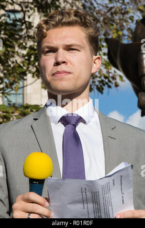 London, UK. 31st October, 2018. Bristol University Robin Boardman-Pattison student Robin reads the formal declaration of non-violent rebellion against the British government for 'criminal inaction in the face of climate change catastrophe and ecological collapse' in Parliament Square. Credit: Mark Kerrison/Alamy Live News - Stock Photo