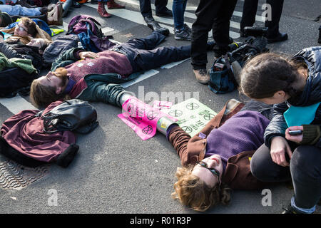 London, UK. 31st October, 2018. Environmental campaigners, some using lock-on tubes, block a road around Parliament Square after making a formal declaration of non-violent rebellion against the British government for 'criminal inaction in the face of climate change catastrophe and ecological collapse'. Credit: Mark Kerrison/Alamy Live News - Stock Photo