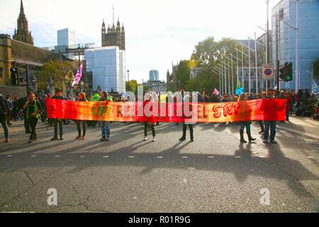 London, UK. 31st October, 2018. Climate change protestors, block roads around Parliament Square, London, UK Credit: Natasha Quarmby/Alamy Live News - Stock Photo