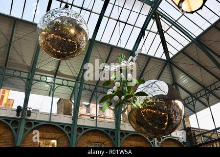 London, UK. 31st October, 2018. Christmas decorations are hung.Christmas Preparations,Covent Garden Piazza,London.UK Credit: michael melia/Alamy Live News - Stock Photo