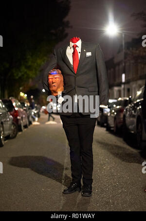 London, UK. 31st October, 2018. A headless Donald Trump Halloween outfit on Winston Road's unofficial huge Trick or Treat party. London, 31 October 2018. Credit: Thomas Bowles/Alamy Live News - Stock Photo