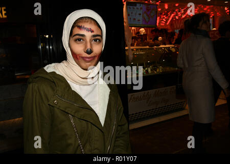 London, UK. 31st Oct, 2018. A lady wearing hijab with Halloween face painting a night in Westend on 31 October 2018, London, UK. Credit: Picture Capital/Alamy Live News - Stock Photo