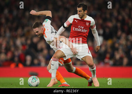 London, UK. 31st Oct, 2018. Henrikh Mkhitaryan of Arsenal and Oliver Turton of Blackpool fight for the ball - Arsenal v Blackpool, Carabao Cup - Fourth Round, Emirates Stadium, London (Holloway) - 31st October 2018  STRICTLY EDITORIAL USE ONLY - DataCo rules apply - The use of this image in a commercial context is strictly prohibited unless express permission has been given by the club(s) concerned. Examples of commercial usage include, but are not limited to, use in betting and gaming, marketing and advertising products. No use with unauthorised audio, video, data, fixture lists, club and or  - Stock Photo