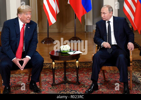 Beijing, Finland. 16th July, 2018. U.S. President Donald Trump (L) meets with Russian President Vladimir Putin in Helsinki, Finland, on July 16, 2018. Credit: Lehtikuva/Heikki Saukkomaa/Xinhua/Alamy Live News - Stock Photo