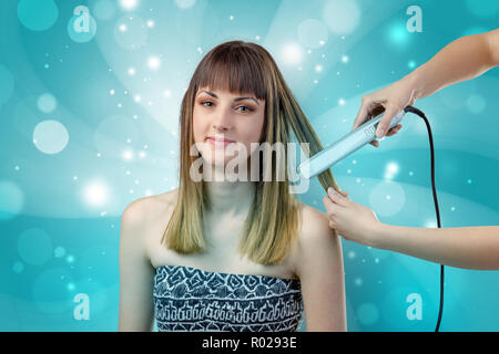 Graceful brunette woman getting ready with shiny turquoise wallpaper  - Stock Photo