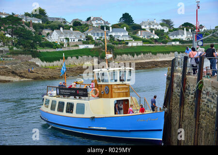 The St. Mawes to Falmouth ferry (named Duchess of Cornwall) arrives at St. Mawes town quay to collect waiting passengers, St.Mawes,Cornwall, UK - Stock Photo