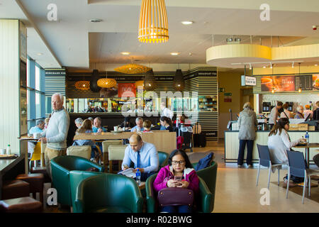2 May 2018 Passengers taking refreshments at the Fusion Restaurant in Belfast City Airport in Northern Ireland as they await their flight departure ti - Stock Photo