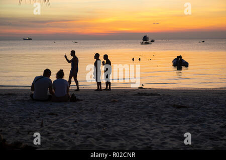 koh tao thailand - march6,2018 : foriegner tourist taking a relax activities on had sai ree beach one of most populart destination in koh tao thailand - Stock Photo