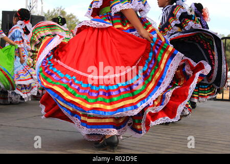 Colorful skirts fly during traditional Mexican dancing - Stock Photo
