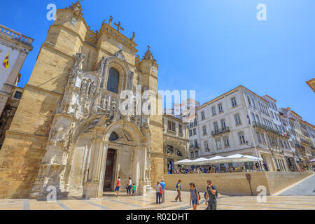 Coimbra, Portugal - August 14, 2017: people in Praca 8 de Maio square with popular main facade of Santa Cruz Monastery and Church. Historic medieval district in Coimbra in Central Portugal, Europe. - Stock Photo