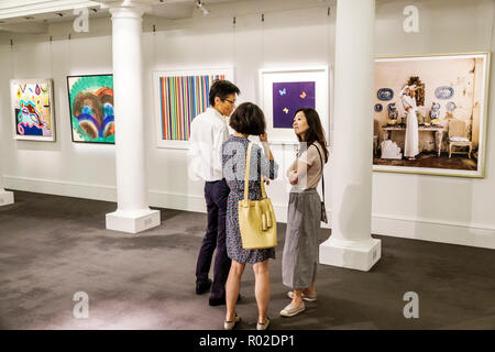London England United Kingdom Great Britain Mayfair New Bond Street Sotheby's fine art auction house interior gallery exhibition Asian man woman coupl - Stock Photo