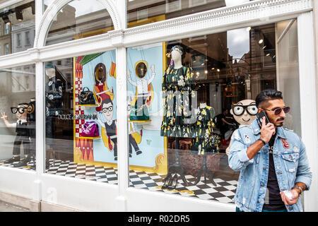 London England United Kingdom Great Britain Mayfair New Bond Street shopping Dolce & Gabbana store exterior upmarket luxury designer brand window disp - Stock Photo