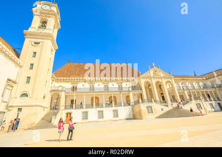 Coimbra, Portugal - August 14, 2017: people at iconic University Clock Tower in Paco das Escolas. The University of Coimbra is the most ancient of Portugal and also one of the oldest in Europe. - Stock Photo
